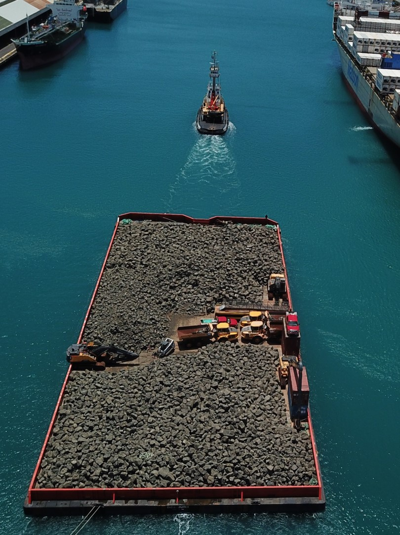 A Volvo fleet traveling by barge to tackle a reef restoration job