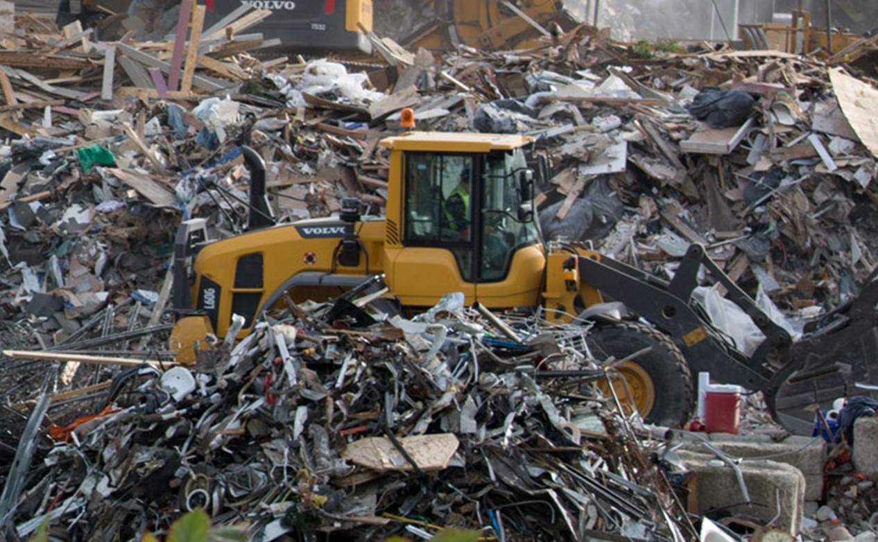 A Volvo L60G sorting scrap in a recycling center