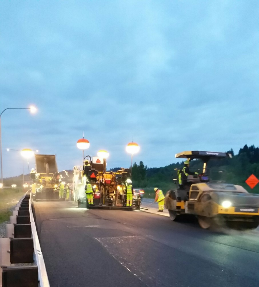 A Volvo paver and roller in action on a Washington state highway