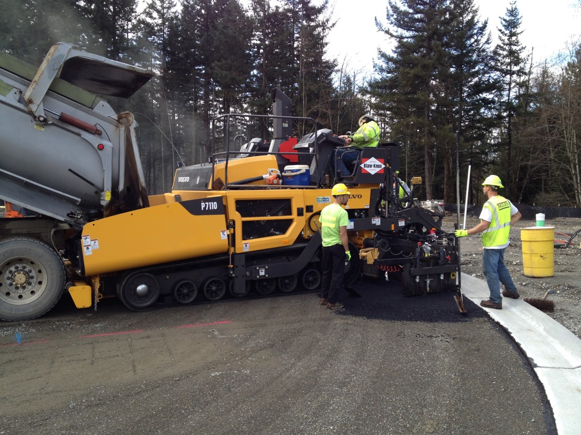 A Volvo P7110 starting to lay asphalt in western Washington